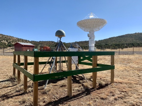 GNSS receiver MGO4 with the VLBI antenna in the background.
