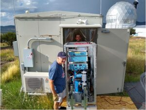 Professor Clark Wilson and Graduate student Chris Linick install the gravimeter.